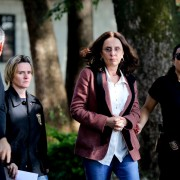 Andrea Neves, sister of Brazilian Senator Aecio Neves, is escorted by federal police officers as she arrives to the Institute of Forensic Science in Belo Horizonte